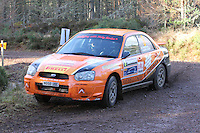 Jock Armstrong - Paula Swinscoe in a Subaru Impreza competing at Junction 6 on the Munro Scotch Beef Millbuie Special Stage 1 on the 2014 Arnold Clark/Thistle Hotel Snowman Rally, supported by Highland Office Equipment, part of Capital Document Solutions which was organised by Highland Car Club and based in Inverness on 22.2.14; Round 1 of the 2014 RAC MSA Scottish Rally Championship sponsored by ARR Craib Transport Limited.