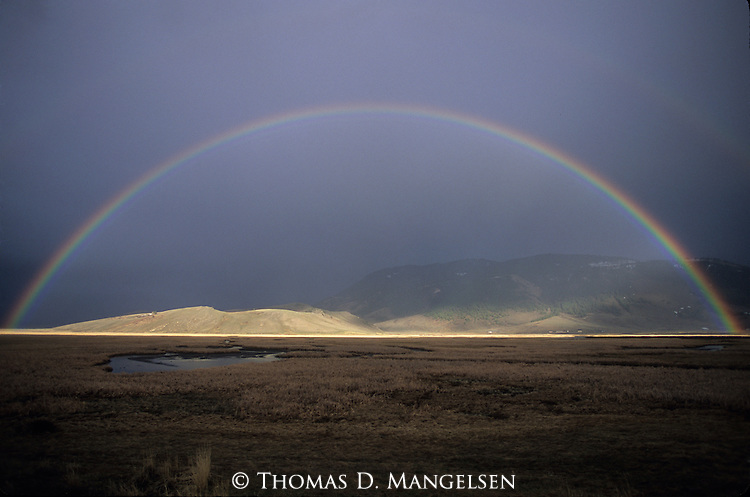 Full rainbow over the National Elk Refuge in Jackson, Wyoming.