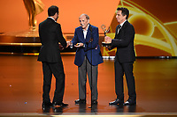 LOS ANGELES - SEPTEMBER 22:   Tony Shalhoub accepts the award for supporting actor in a comedy series with Bob Newhart and Ben Stiller onstage at the 71st Primetime Emmy Awards at the Microsoft Theatre on September 22, 2019 in Los Angeles, California. (Photo by Frank Micelotta/Fox/PictureGroup)