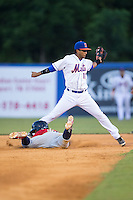 Luis Carpio (11) of the Kingsport Mets reaches for a throw as Ariel Montesino (35) of the Elizabethton Twins dives head first into second base at Hunter Wright Stadium on July 9, 2015 in Kingsport, Tennessee.  The Twins defeated the Mets 9-7 in 11 innings. (Brian Westerholt/Four Seam Images)