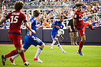Ashley Cole (3) of Chelsea FC crosses the ball to Marko Marin (21). Chelsea FC and Paris Saint-Germain played to a 1-1 tie during a 2012 Herbalife World Football Challenge match at Yankee Stadium in New York, NY, on July 22, 2012.