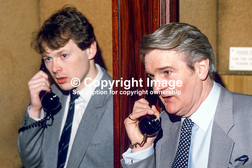 .Stephen Eastwood, Belfast, N Ireland, professional boxing promoter, left, and Paddy Byrne, boxing matchmaker, Portslade, UK, on the phones to resolve last minute hitch. 19840042SE+PB..Copyright Image from Victor Patterson, 54 Dorchester Park, Belfast, UK, BT9 6RJ..Tel: +44 28 9066 1296.Mob: +44 7802 353836.Voicemail +44 20 8816 7153.Skype: victorpattersonbelfast.Email: victorpatterson@me.com.Email: victorpatterson@ireland.com (back-up)..IMPORTANT: If you wish to use this image or any other of my images please go to www.victorpatterson.com and click on the Terms & Conditions. Then contact me by email or phone with the reference number(s) of the image(s) concerned.