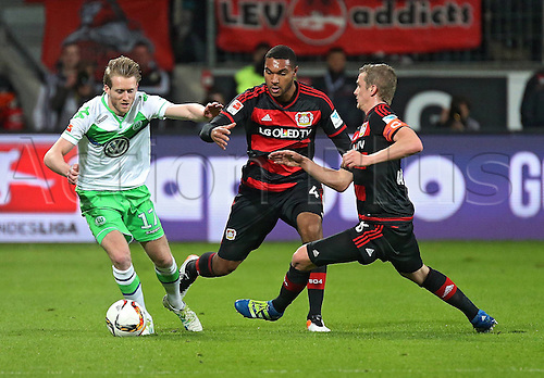 01.04.2016. Leverkusen, Germay. Bundesliga football. Bayer Leverkusen versus VFL Wolfsburg in the BayArena in Leverkusen. Andre Schuerrle (VfL Wolfsburg), Jonathan Tah (Bayer 04 Leverkusen), Lars Bender (Bayer 04 Leverkusen)