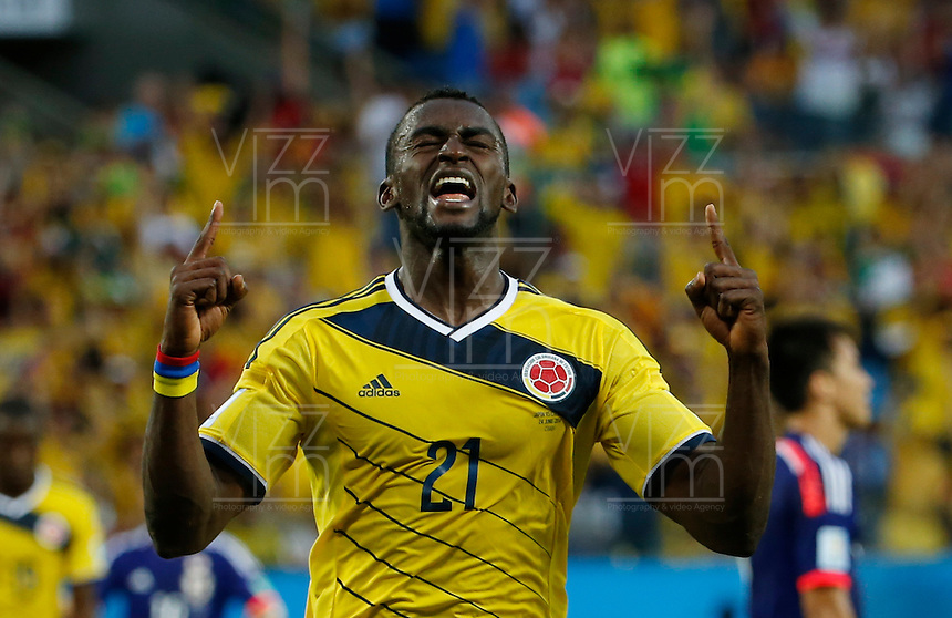 CUIABA - BRASIL -24-06-2014. Foto: Roberto Candia / Archivolatino<br /> Jackson Martinez (#21) jugador de Colombia (COL) celebra un gol anotado a Japón (JPN) durante partido del Grupo C de la Copa Mundial de la FIFA Brasil 2014 jugado en el estadio Arena Pantanal de Cuiaba./ JJackson Martinez (#21) player of Colombia (COL) celebrates a goal scored to Japan (JPN) during the macth of the Group C of the 2014 FIFA World Cup Brazil played at Arena Pantanal stadium in Cuiaba. Photo: Roberto Candia / Archivolatino<br /> VizzorImage PROVIDES THE ACCESS TO THIS PHOTOGRAPH ONLY AS A PRESS AND EDITORIAL SERVICE IN COLOMBIA AND NOT IS THE OWNER OF COPYRIGHT; ANOTHER USE IS REPONSABILITY OF THE END USER. NO SALES, NO MERCHANDASING. ALL COPYRIGHT IS ARCHIVOLATINO