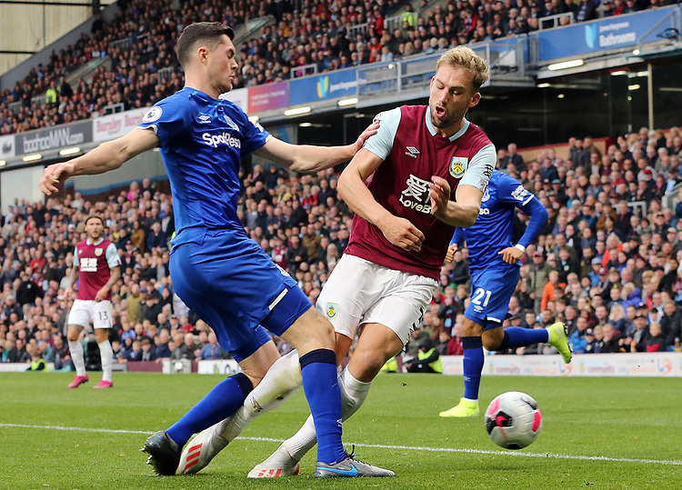 Burnley's Charlie Taylor is tackled by Everton's Michael Keane<br /> <br /> Photographer Rich Linley/CameraSport<br /> <br /> The Premier League - Burnley v Everton - Saturday 5th October 2019 - Turf Moor - Burnley<br /> <br /> World Copyright © 2019 CameraSport. All rights reserved. 43 Linden Ave. Countesthorpe. Leicester. England. LE8 5PG - Tel: +44 (0) 116 277 4147 - admin@camerasport.com - www.camerasport.com