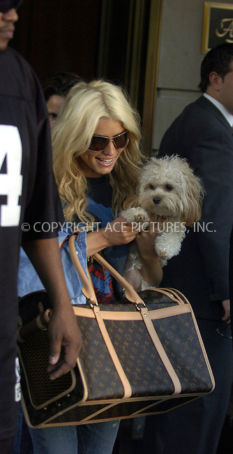 WWW.ACEPIXS.COM ** ** ** ....NEW YORK, SEPTEMBER 28, 2005....While leaving her midtown hotel, Jessica Simpson gets her dog to give our photographers a wave.....Please byline: Philip Vaughan -- ACE PICTURES... *** ***  ..Ace Pictures, Inc:  ..Craig Ashby (212) 243-8787..e-mail: picturedesk@acepixs.com..web: http://www.acepixs.com