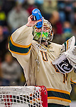 14 December 2013: University of Vermont Catamount Goaltender Brody Hoffman, a Sophomore from Wilkie, Saskatchewan, hydrates prior to starting against the Saint Lawrence University Saints at Gutterson Fieldhouse in Burlington, Vermont. The Catamounts defeated their former ECAC rivals, 5-1 to notch their 5th straight win in NCAA non-divisional play. Mandatory Credit: Ed Wolfstein Photo *** RAW (NEF) Image File Available ***