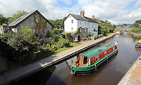 WEATHER PICTURE WALES<br />Pictured: A barge travels in Brecon Canal, Wales, UK. Monday 18 July 2016<br />Re: Sunshine and high temperatures are due to affect most of the UK this week.