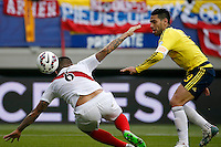 TEMUCO - CHILE – 21-04-2015: Radamel Falcao Garcia (Der.) jugador de Colombia, disputa el balón con Juan Vargas (Iz.) jugador de Peru, durante partido Colombia y Peru, por la fase de grupos, Grupo C, de la Copa America Chile 2015, en el estadio German Becker en la Ciudad de Temuco  / Radamel Falcao Garcia (R) player of Colombia, vies for the ball with Juan Vargas (L) player of Peru, during a match between Colombia and Peru, for the group phase, Group C, of the Copa America Chile 2015, in the German Becker stadium in Temuco city. Photos: VizzorImage /  Photosport / Dragomir Yankovic    / Cont.