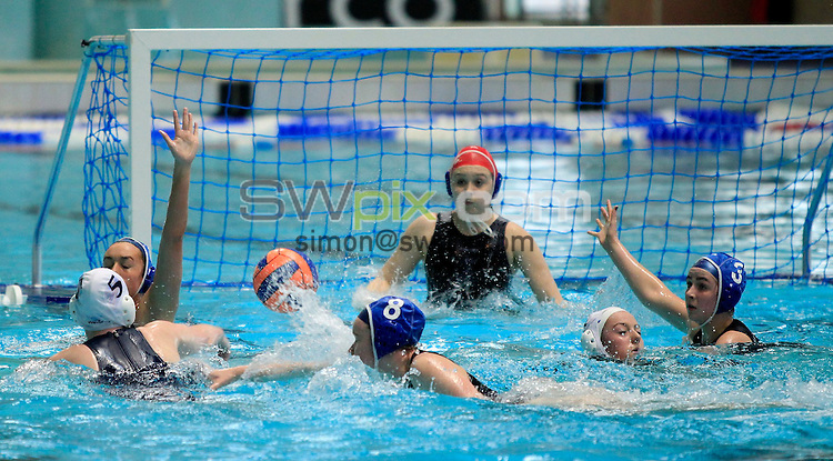 PICTURE BY CHRIS MANGNALL /SWPIX.COM... Swimming - British Gas National ASA Age Group Water Polo Championship 2011 Junior And Youth Boys and Girls Finals  - City of Manchester v City of Liverpool -Manchester Aquatics Center, Manchester, England  - 16/04/11... Manchester (White Cap) score v   Liverpool (Blue Cap)      in the Junior Girls Final