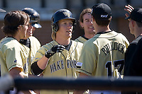 Willy Fox (9) of the Wake Forest Demon Deacons is congratulated by his teammates following his solo home run versus the Clemson Tigers during the second game of a double header at Gene Hooks Stadium in Winston-Salem, NC, Sunday, March 9, 2008.