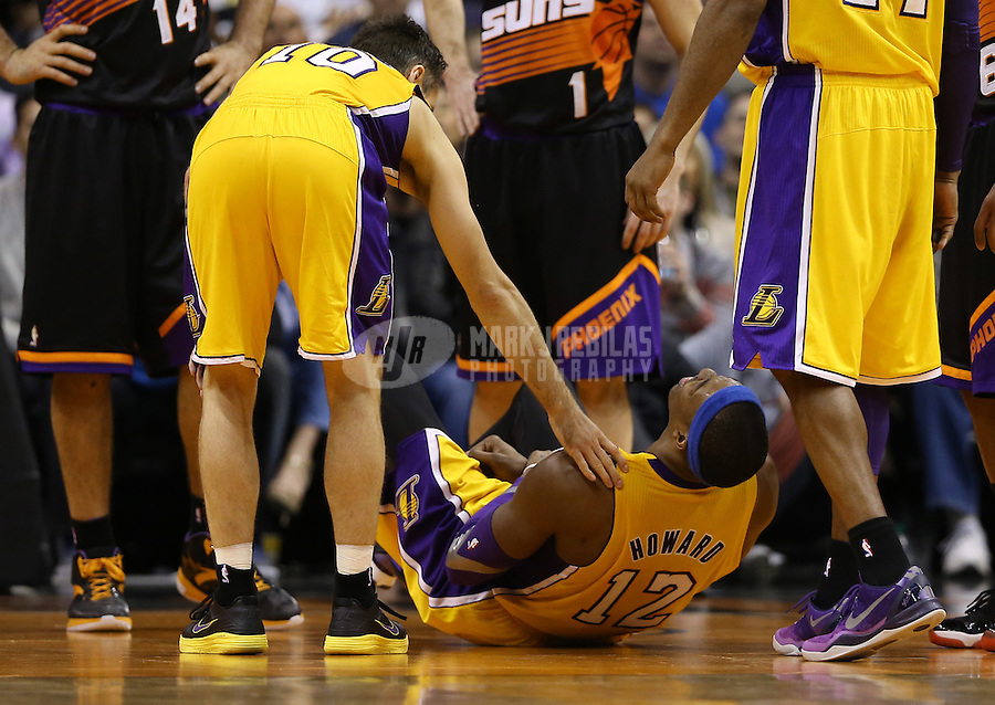 Jan. 30, 2013; Phoenix, AZ, USA: Los Angeles Lakers guard Steve Nash (left) tends to center Dwight Howard as he reacts after suffering an injury in the second half against the Phoenix Suns at the US Airways Center. The Suns defeated the Lakers 92-86.  Mandatory Credit: Mark J. Rebilas-
