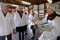 Tour leader Etsuko Nakamura talks to tour participants. Marumoto Sake Brewery, Asakuchi city, Okayama Pref, Japan, January 28, 2014. Okayama is famous for its earthy full-bodied sake. In January and February 2014 a 5-day tour of breweries in the prefecture was organised by Sake Brewery Tours (www.saketours.com).