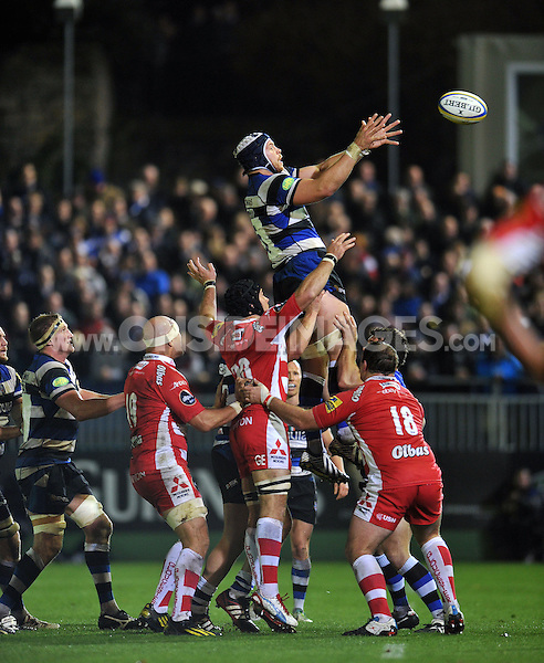 Dave Attwood rises high to win lineout ball. Aviva Premiership match, between Bath Rugby and Gloucester Rugby on October 25, 2013 at the Recreation Ground in Bath, England. Photo by: Patrick Khachfe / Onside Images