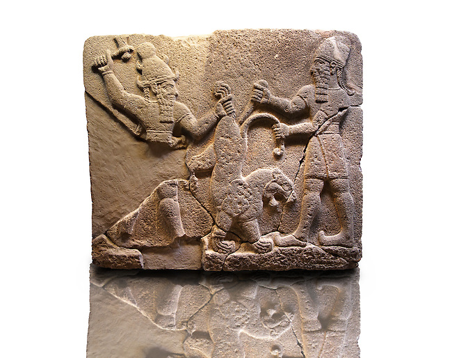 Picture & Image of  Neo-Hittite orthostat describing the legend of Gilgamesh from Karkamis,, Turkey. Museum of Anatolian Civilisations, Ankara. To the left a bearded deity with a horned helmet is holding a lions back leg and is about to strike it with an axe. To the right a man is stabbing the lion with a dagger. 5