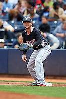New Britain Rock Cats first baseman Dean Espy (7) waits for a throw holding a runner on during a game against the Akron RubberDucks on May 21, 2015 at Canal Park in Akron, Ohio.  Akron defeated New Britain 4-2.  (Mike Janes/Four Seam Images)