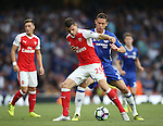 Arsenal's Granit Xhaka tussles with Chelsea's Nemanja Matic during the Premier League match at the Emirates Stadium, London. Picture date September 24th, 2016 Pic David Klein/Sportimage