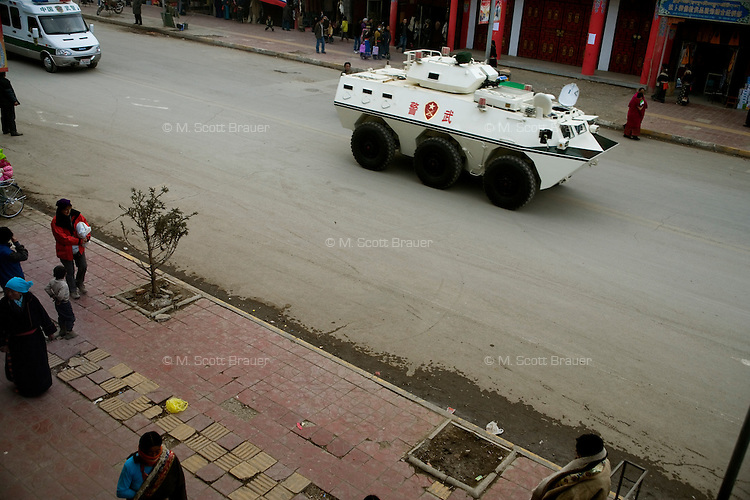 Armored tanks and trucks patrol the streets of Xiahe, Gansu, China.  The city, home to the Labrang Monastery, is an important religious site outside of Tibet for Tibetan Buddhists. Since uprisings in 2008, the city has been under military and police surveillance.
