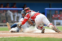 Batavia Muckdogs catcher Felix Castillo (30) tags out Nellie Rodriguez attempting to score a run during a game against the Mahoning Valley Scrappers on September 1, 2013 at Dwyer Stadium in Batavia, New York.  Mahoning Valley defeated Batavia 6-0.  (Mike Janes/Four Seam Images)