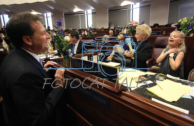 "The children of Nevada Sen. Ben Kieckhefer, R-Reno, sing ""Home Means Nevada"" to Lt. Gov. Brian Krolicki, left, during the opening day of the 77th Legislative Session in Carson City, Nev. on Monday, Feb. 4, 2013. (AP Photo/Cathleen Allison)"