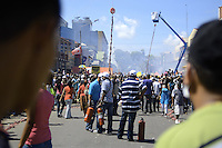Attendants are waiting with fire extinguishes while the visitors are waiting for explosion of long firecrackers and watching its installation in the city.....End of year 2010 celebrations on the streets of Paramaribo. Suriname is one of biggest consumer in South America that using firecrackers, fireworks ( also locally known as pagara ) for celebrations, especially for end of every years and also beginning of every new Chinese Years.