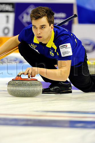 02.04.2012 Basel, Switzerland. Sweden second Oskar Eriksson in action during day three of the Mens World Curling Championships from St Jakobshalle.