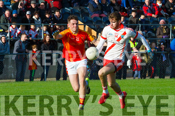 Eanna O Conchuir An Ghaeltacht goes past James Loughrey  Mallow during the Munster Intermediate Championship semi final in Mallow on Sunday