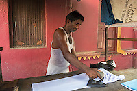 Ironing clothes In the streets of Kolkata, West Bengal India