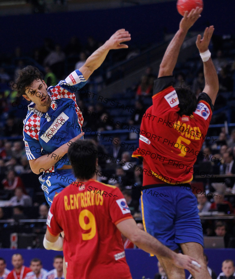 BELGRADE, SERBIA - JANUARY 29:  Jorge Maqueda (R) of Spain blocked shoots of Marko Kopljar (L) during the Men's European Handball Championship 2012 Bronze medal match between Croatia and Spain at Arena Hall on January 29, 2012 in Belgrade, Serbia.  (Photo by Srdjan Stevanovic/Starsportphoto.com ©)