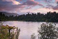 Sunset over Lake Mapourika near Franz Josef Glacier with mountains in background, Westland NP, West Coast, South Westland, New Zealand