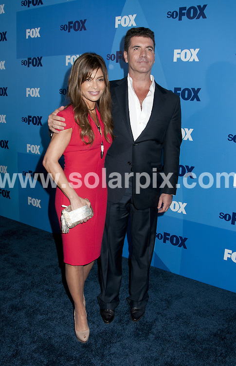**ALL ROUND PICTURES FROM SOLARPIX.COM**                                             **SYNDICATION RIGHTS FOR UK, AUSTRALIA, DENMARK, PORTUGAL, S. AFRICA, SPAIN & DUBAI (U.A.E) & ASIA (EXCLUDING JAPAN) ONLY**                                                                                  Caption: Arrivals at 2011 Fox Upfront, held at the Wollman Rink, Central Park, New York City, NY, USA. 16 May 2011                                                                              This pic: Paula Abdul and Simon Cowell                                                                                             JOB REF: 13356 PHZ Mayer      DATE: 16_05_2011                                                           **MUST CREDIT SOLARPIX.COM OR DOUBLE FEE WILL BE CHARGED**                                                                      **MUST AGREE FEE BEFORE ONLINE USAGE**                               **CALL US ON: +34 952 811 768 or LOW RATE FROM UK 0844 617 7637**