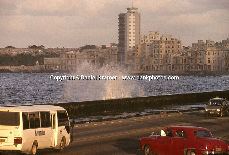 A red 1950 Dodge turning on to the Malecon in Havana, Cuba - 1998