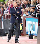 Ally McCoist joking with the Hearts fans behind the RAngers dugout