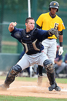 GCL Braves catcher Troy Snitker #2 throws to second after fielding a bunt during a game against the GCL Pirates at Disney Wide World of Sports on June 25, 2011 in Kissimmee, Florida.  The Pirates defeated the Braves 5-4 in ten innings.  (Mike Janes/Four Seam Images)