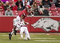 Hawgs Illustrated/BEN GOFF <br /> T.J. Hammonds, Arkansas running back, tries to break the tackle Cameron Dantzler, Mississippi State defensive back, in the first quarter Saturday, Nov. 18, 2017, at Reynolds Razorback Stadium in Fayetteville.