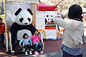 April 1, 2011, Tokyo, Japan - A sister pose for a photograph with stuffed panda at Ueno Zoo in Tokyo on Friday, April 1, 2011. Thousands of visitors flocked to catch a first glimpse of a pair of pandas on loan from China, in a welcome respite from the gloom over last month's massive earthquake and tsunami in northern Japan. (Photo by Daiju Kitamura/AFLO) [1045] -ty-.