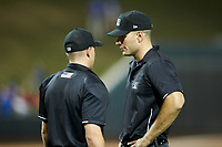 Home plate umpire Steven Jaschinski (left) discusses a call with umpire Dane Poncsak during the Carolina League game between the Carolina Mudcats and the Winston-Salem Dash at BB&T Ballpark on June 1, 2019 in Winston-Salem, North Carolina. The Dash defeated the Mudcats 5-4 in game two of a double header. (Brian Westerholt/Four Seam Images)