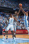 Olivier Sarr (30) of the Wake Forest Demon Deacons battles for the ball with Joel Berry II (2) of the North Carolina Tar Heels during first half action at the Dean Smith Center on December 30, 2017 in Chapel Hill, North Carolina.  The Tar Heels defeated the Demon Deacons 73-69.  (Brian Westerholt/Sports On Film)