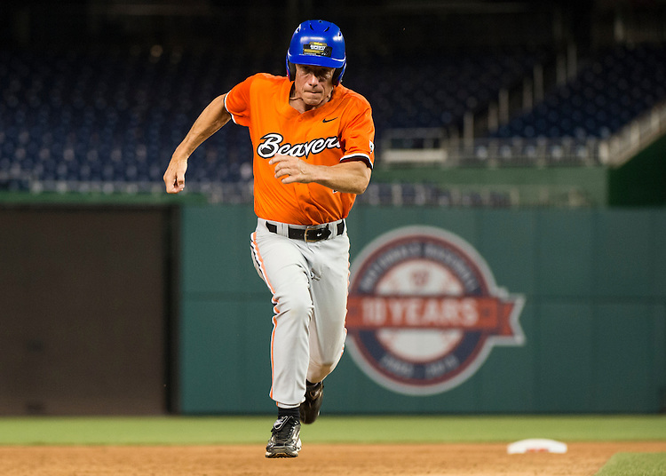 UNITED STATES - JUNE 11: Rep. Kurt Schrader, D-Ore., steals third base during the 54th Annual Roll Call Congressional Baseball Game at Nationals Park in Washington on Thursday, June 11, 2015. The Democrats beat the Republicans 5-2. (Photo By Bill Clark/CQ Roll Call)