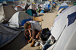 RENO, NV - OCTOBER 6:  A homeless man gets dressed in a tent city for the homeless in downtown Reno, Nevada October 6, 2008. The City of Reno set up the tent city when existing shelters became overcrowded as Nevada struggles with one of the highest unemployment rates in the country. (Photo by Max Whittaker/Getty Images)
