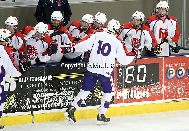 Cherry Creek celebrates Noah Ingwers' goal (No. 10).  Cherry Creek (Colorado) beat Medina (Ohio) 5-1 on the third day of pool play during the 2014 High School Hockey National Championship in Omaha on March 28. (Photo by Michelle Bishop)