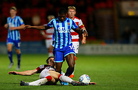 Blackpool's Sullay Kaikai is tackled by Doncaster Rovers' Ben Sheaf<br /> <br /> Photographer Alex Dodd/CameraSport<br /> <br /> The EFL Sky Bet League One - Doncaster Rovers v Blackpool - Tuesday September 17th 2019 - Keepmoat Stadium - Doncaster<br /> <br /> World Copyright © 2019 CameraSport. All rights reserved. 43 Linden Ave. Countesthorpe. Leicester. England. LE8 5PG - Tel: +44 (0) 116 277 4147 - admin@camerasport.com - www.camerasport.com