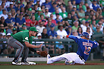 Diamondbacks' Brandon Drury waits for the throw as Chicago Cubs' Kyle Schwarber gets a triple in a spring training game in Mesa, Ariz., on Thursday, March 17, 2016. The Cubs won 15-4.<br />Photo by Cathleen Allison