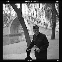 An elderly Chinese man dressed in Mao suit visits the Summer Palace in Beijing, China, April 2014. (Mamiya 6, 75mm, Kodak TRI-X film)