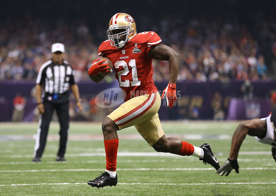 Feb 3, 2013; New Orleans, LA, USA; San Francisco 49ers running back Frank Gore (21) scores a touchdown against the Baltimore Ravens in the third quarter during Super Bowl XLVII at the Mercedes-Benz Superdome.  Mandatory Credit: Mark J. Rebilas-