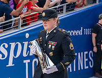ORLANDO, FL - MARCH 05: The military escort carries the SheBelieves trophy during a game between Spain and Japan at Exploria Stadium on March 05, 2020 in Orlando, Florida.