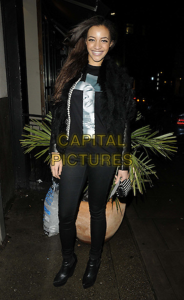 Amal Fashanu.attended the Casio Tokyo Trio Watch launch party, The Study, Blandford St., London, England..January 28th, 2013.full length black top jeans denim boots fur gilet sleeveless cross crucifix print.CAP/CAN.©Can Nguyen/Capital Pictures.