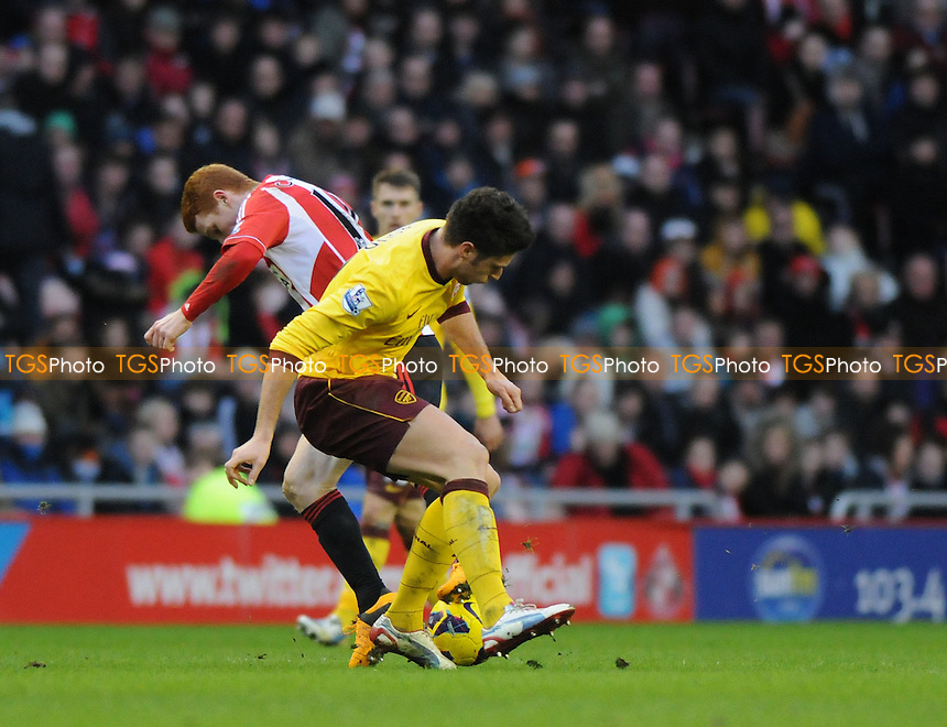 Sunderland's Jack Colback battles with Mikel Arteta of Arsenal - Sunderland vs Arsenal - Barclays Premier League Football at The Stadium of Light, Sunderland, Tyne & Wear - 09/02/13 - MANDATORY CREDIT: Steven White/TGSPHOTO - Self billing applies where appropriate - 0845 094 6026 - contact@tgsphoto.co.uk - NO UNPAID USE.