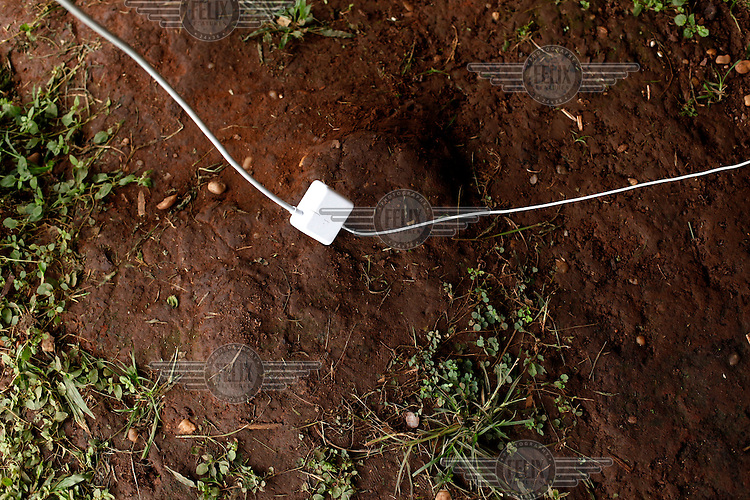 A computer cable lies on the ground at a meeting of tribal leaders in the village of Lapetanha, in the Brazilian Amazon, arranged to discuss projects such as reforestation and tourism. The Surui had had no contact with the world outside their Amazonian homelands until, in 1969, a road was built through their territory. At the time there were around 5000 Surui but within three years disease had wiped out all but 290 Surui.