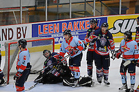 IJSHOCKEY: THIALF: Heerenveen, 22-02-2012, Friesland Flyers - HYS Den Haag, goalie Martijn Oosterwijk (30), TJ Caig (61), Eindstand 2-5, face-off, ©foto: Martin de Jong